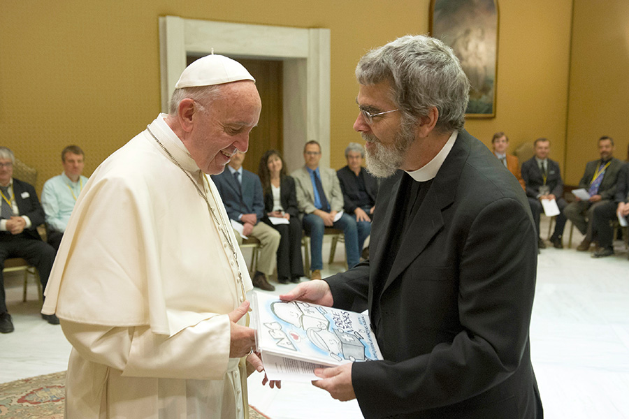 Pope Francis accepts a gift from Jesuit Brother Guy Consolmagno, director of the Vatican Observatory, during a May scientific conference at the Vatican. Faith and science are shifting from opposition to cooperation, said Brother Guy, an astronomer.  (L'Osservatore Romano)