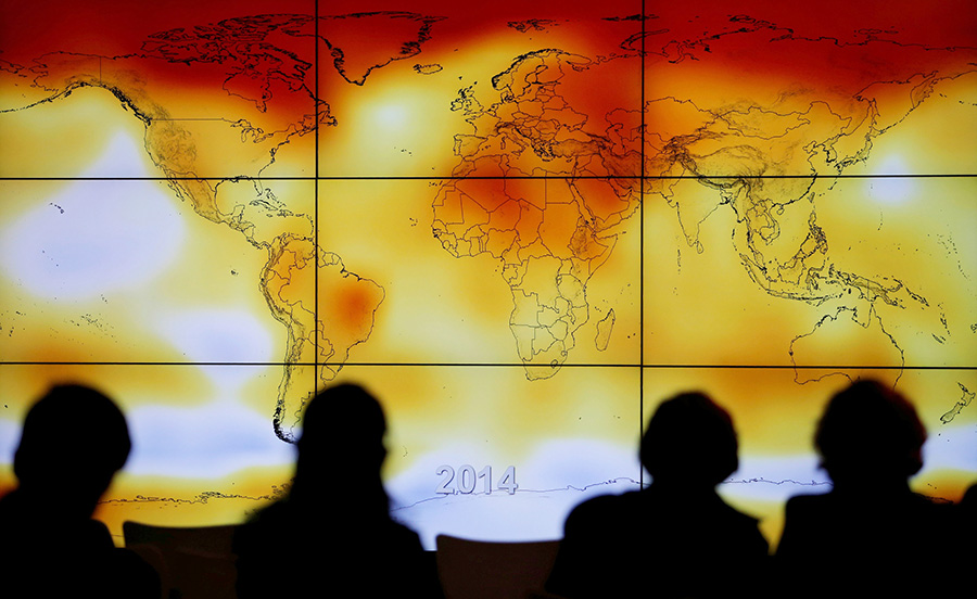 Participants look at a screen showing a world map with climate anomalies during the World Climate Change Conference at Le Bourge, France in 2015. The church and science likely will cooperate in the coming decades on protecting the planet.  (Stephane Mahe/Catholic News Service)