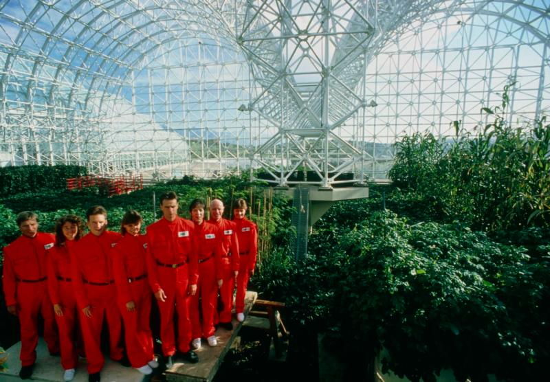 Crew members pose for the camera during the final construction phase of the Biosphere 2 project in 1990. The 3.1 acre air-and-water-tight building became their home for two years. (CNS photo/courtesy Philippe Plailly, Science Photo Library)