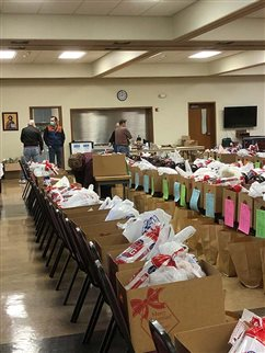 St. Cecilia's St. Vincent de Paul hustles to help with funds for fire-ravaged communities, food boxes for needy